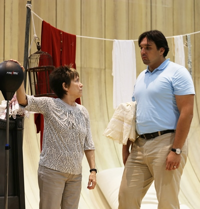 Director Barbara Gaines makes a point to her wily, imposing Figaro (Adam Plachetka). (Andrew Cioffi)