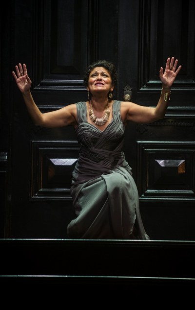 Clytemnestra (Sandra Marquez) knows she will soon have Agamemnon in her grasp. (Michael Brosilow)