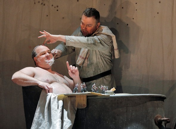 To glean extra money, Wozzeck (Tomasz Konieczny) shaves the Captain (Gerhard-Siegel). (Cory Weaver)
