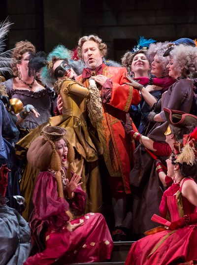 Lord Capulet (Philip Horst) is surrounded by a chorus of happy revelers. (Todd Rosenberg)