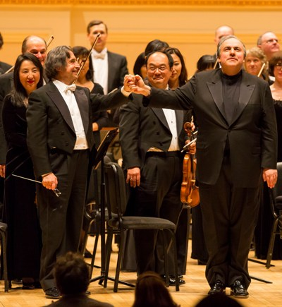 Riccardo Muti and pianist Yefim Bronfman share an ovation for Brahms' Second Piano Concerto at Carnegie Hall. (Todd Rosenberg)