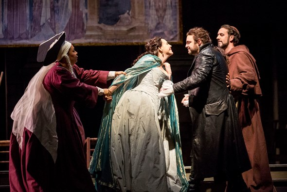 Just married, but secretly, Juliet (Susanna Phillips) is pulled away by her nurse (Deborah Nansteel) and Friar Lauence (Christian Van Horn) tugs at Romeo (Joseph Calleja). (Todd Rosenberg)