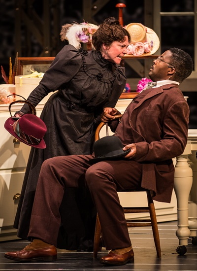 Irene (Elizabeth Ledo) encourages Cornelius (Postell Pringle) to take her to a swell restaurant. (Liz Lauren)