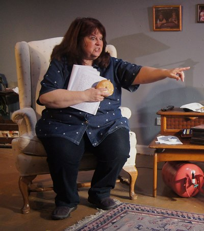 Margaret (Debra Rodkin) clutches her first draft of her mother's eulogy, and a supporting bagel. (Jan Ellen Graves).