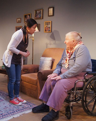 The new care-giver (Stephanie Shum) reminds Emily (Kathleen Ruhl) of a shared past. (Jan Ellen Graves)