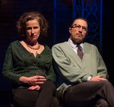 Martha (Karen Janes Woditsch) and George (John Hoogenakker) sip from alcohol and resentment. (Michael Brosilow)