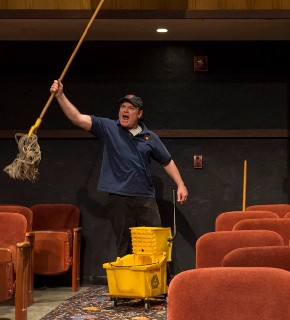 Sam (Danny McCarthy), in an exultant moment, flourishes his mop. (Michael Brosilow)