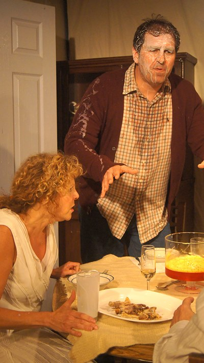 Hannah (Jacqueline Grandt) and Thomas (Mark Pracht) are both stunned when he gets a milk bath. (Jan Ellen Graves)(