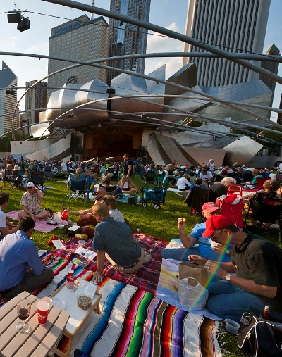 Picnickers hang out on the lawn for a concert at the Grant Park Music Festival (Norman Timonera)