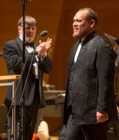 Conductor Andrew Davis applauded baritone Quinn Kelsey's aria from 'Don Carlo.' (Todd Rosenberg)