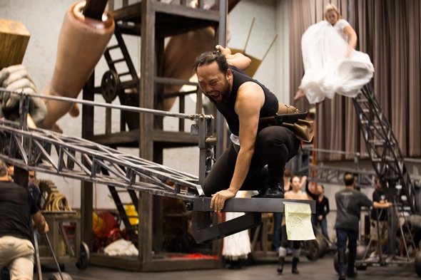 Samuel Youn, as Alberich, clambers on the set structure in a 'Rheingold' rehearsal. (Andrew Cioffi)
