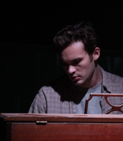 Bobbie (Carson Schroeder) finds solitary peace at the piano. (Gregg Gilman)