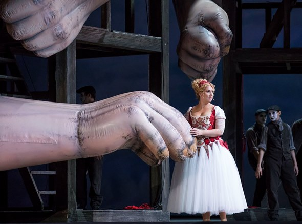 The goddess Freia (Laura Wilde) seems to take a liking to Fasolt's really big hand. (Todd Rosenberg)
