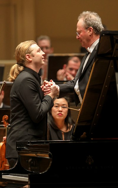 Pianist Denis Kozhukhin and conductor Emmanuel Krivine after their fiery journey through Prokofiev's Second Concerto. (Todd Rosenberg)