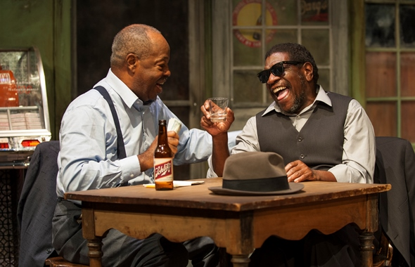 Cafe regulars Columbus Frye (Alfred Wilson, left) and Adolph (Willie B.) share a laugh and a drink. (Michael Brosilow)