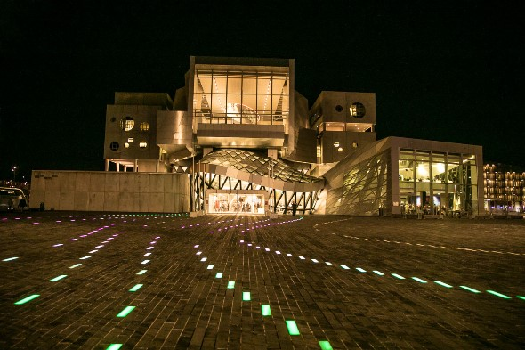 Aalborg's Musikkens Hus at night: Sharp angles on the outside, curves in the hall. (Todd Rosenberg)