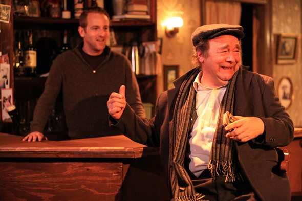 Pub owner Brendan (Bradley Grant Smith, left) enjoys a tale by his pal Jack (Brad Armacost). (Emily Schwartz)