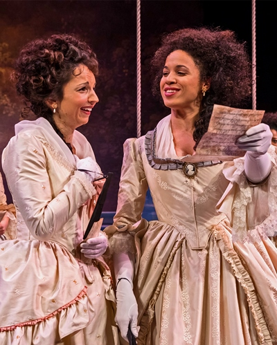 Rosaline (Laura Rook, left) and the French Princess (Jenny Greenberry) puzzle over an errant letter. (Liz Lauren)