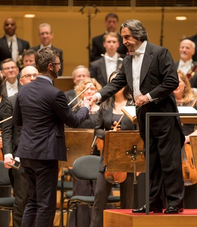 "Riccardo Muti congratulates composer Samuel Adams after the premiere of his ""many words of love."" (Todd Rosenberg)"