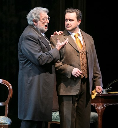 "Domingo with tenor Michael Spyres as the Germonts, pere et fils, in ""La traviata."" (Todd Rosenberg)"