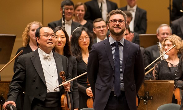 "Composer Samuel Adams accepts the ovation for his new work ""many words of love,' given its premiere by the Chicago Symphony Orchestra. (Todd Rosenberg)"