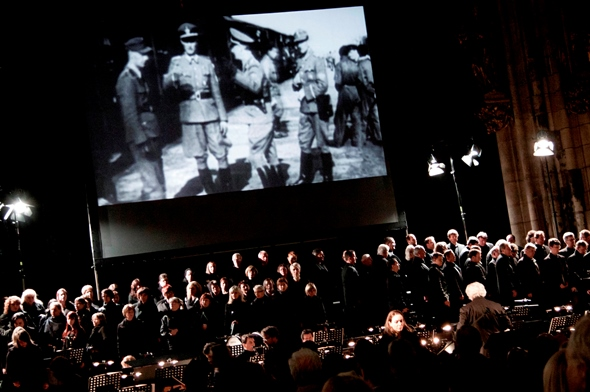 """Defiant Requiem"" blends video clips with the musical performance and narrative. (Josef Rabara)"