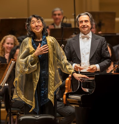 Pianist Mitsuko Uchida and CSO music director Riccardo Muti share in the applause for Beethoven's Third Piano Concerto. (Todd Rosenberg)