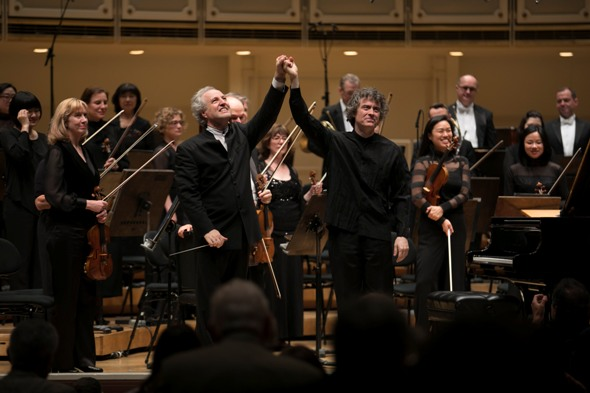 Conductor Manfred Honeck and pianist Paul Lewis take a bow at the all-Mozart concert by the Chicago Symphony June 8. (Todd Rosenberg)