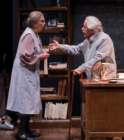 A dour housekeeper (Ann Whitney) looks after Einstein (Mike Nussbaum). (Michael Brosilow)