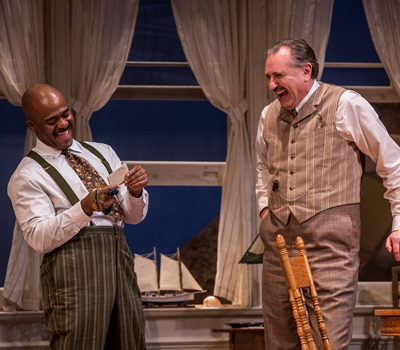 Nat Miller (Randall Newsome, right) and his brother-in-law Sid (Larry Bates) enjoy a poetry reading. (Liz Lauren)