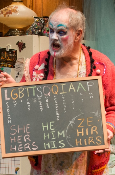 "Dad (Francis Guinan) displays the new gender order. Call it ""Lugabuttsqueehah."" (Michael Brosilow)"