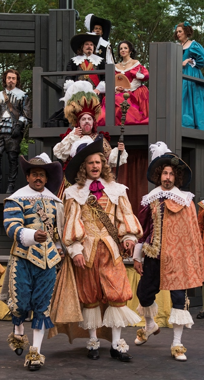 Courtly dandies show off their finery in an evening at the theater. (Michael Brosilow)