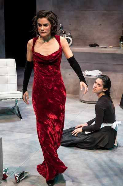 Madame's empowering red dress gives maid Claire (Melisa Pereyra) dominance over Solange (Andrea San Miguel). (Liz Lauren)