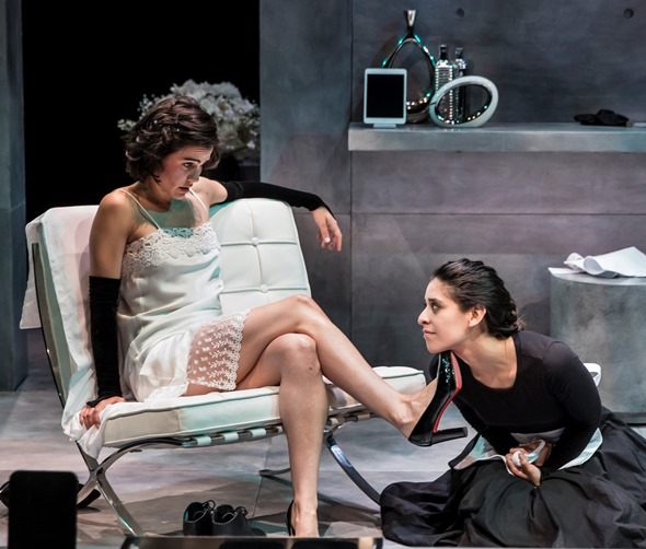 "In ""The Maids,"" Claiire (Melisa Pereya) acts out as Madame with her sister Solange (Andrea San Miguel) at her feet. (Liz Lauren)"