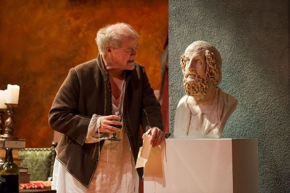Francis Guinan, as Rembrandt, communes with a bust of Homer. (Michael Brosilow)