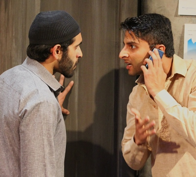 Dar (Arnand Bhatt, on the phone) shares shocking news with Bashir (Owais Ahmed).