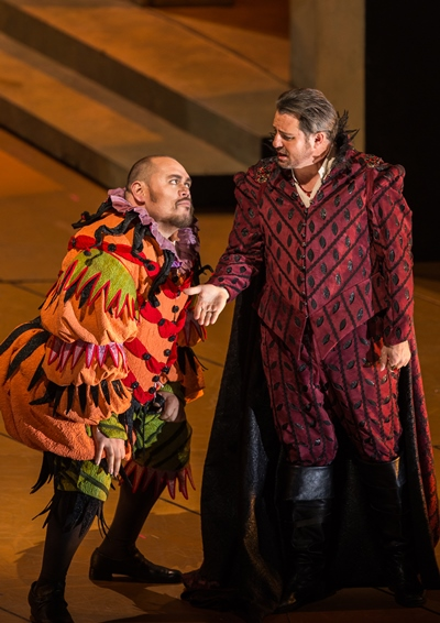 The bitter jester Rigoletto (Quinn Kelsey) pays grudging court to the Duke (Matthew Polenzani). (Todd Rosenberg)