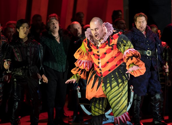The jester Rigoletto (Quinn Kelsey) has an edgy relationship with the Duke's courtiers. (Todd Rosenberg)