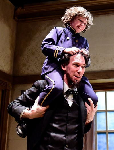 A beleaguered President Lincoln (Lawrence Grimm) still has time for son Tad (Leo Sharkey). (Evan Hanover)