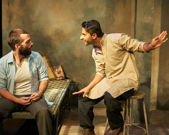 Good-natured Dar (Anand Bhatt) brings some cheer to Rnick's (Joel Reitsma) incarceration. (Lee Miller)