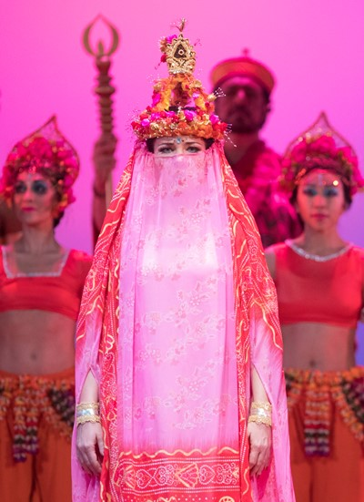 A veiled priestess (Marina Rebeka) arrives to pray for the pearl fishers. (Todd Rosenberg)