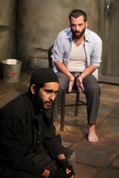 Nick (Joel Reitsma) appeals to the compassion of his captor Bashir (Owais Ahmed).