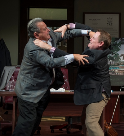 A disagreement gets physical between two council members (Jeff Still, left, and Danny McCarthy). (Michael Brosilow)