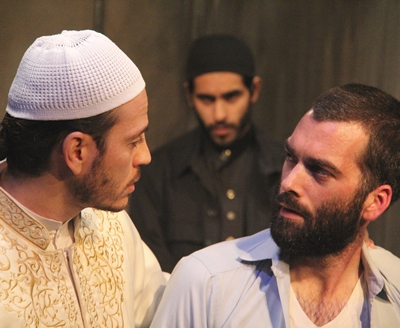 As Bashir (Owais Ahmed) looks on, Nick (Joel Reitsma) contends with the Imam (Bassam Abdelfattah). (Gregg Gilman)