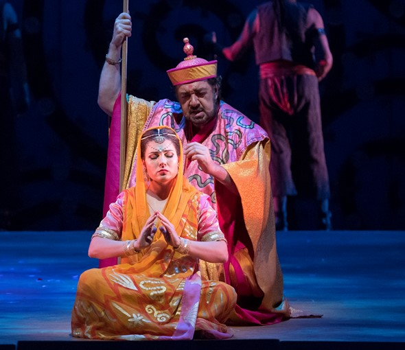 The high priest Nourabad (Andrea Silvestrelli) instructs Leïla to pray for the pearl fishers in solitude. (Todd Rosenberg)