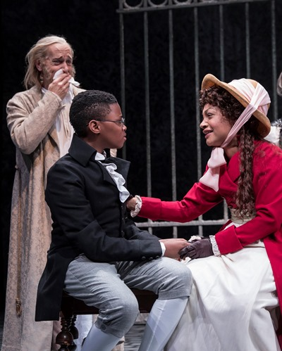 Revisiting his own past, Scrooge (Larry Yando) beholds himself as a boy (Cameron Goode) with his sister Fan (Ariana Burks). (Liz Lauren)